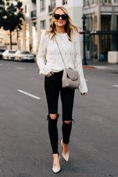 sweater,white sweater,black ripped jeans,skinny jeans,high heel pumps,crossbody bag,knitted sweater,black sunglasses