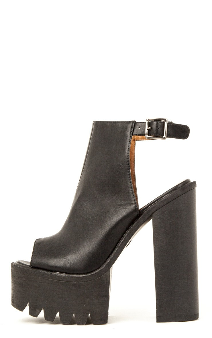 Carmen black sling back cleated sole shoes