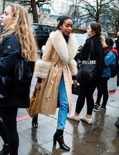 coat,nude coat,shearling jacket,fur collar coat,boots,jeans,denim,blue jeans,black boots,streetstyle