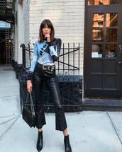 pants,faux leather,flare pants,cropped pants,black pants,ankle boots,shoulder bag,belt,dior