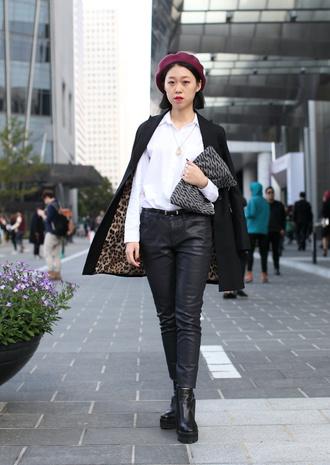 hat white shirt leather pants black boots black coat burgundy beret blogger