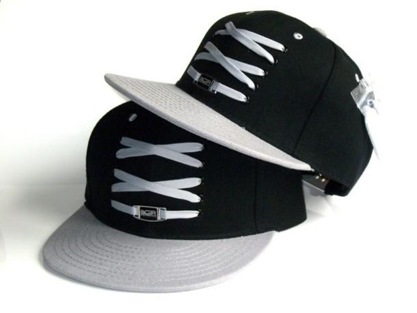 hat white laces black snap back