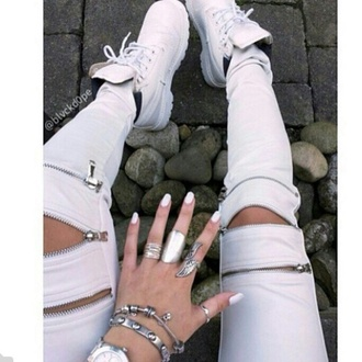 pants jeans ripped jeans zipper kylie jenner white trainers summer outfits all white timberland boots boots fashion style trendy shoes