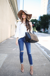 southern curls and pearls,blogger,blouse,jeans,bag,shoes,hat,jewels,make-up,animal print,white top,long sleeves,skinny jeans,ripped jeans,floppy hat,lace up heels,nude heels