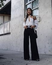 pants,tumblr,black pants,wide-leg pants,top,white top,cut out shoulder,cut-out shoulder top,double buckle belt,belt,bag,black bag,black wide-leg velvet pants