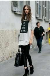 top,graphic tee,black,black jeans,black shoes,shoes,bag,black bag,t-shirt,ankle boots,black boots,black ankle boots,leather leggings,grey sweater,black tote,streetstyle,slogan t-shirts,streetwear
