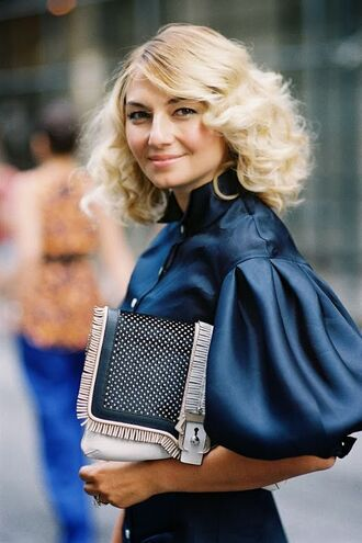 shirt puffed sleeves blue top three-quarter sleeves blue shirt blouse clutch streetstyle hairstyles curly hair blonde hair