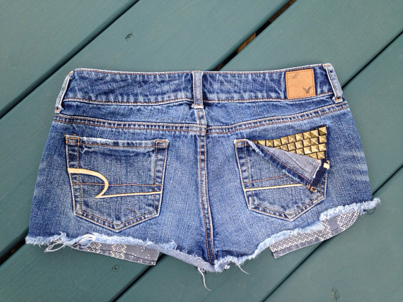 Studded pocket distressed cutoff denim shorts  by lydiaegallagher