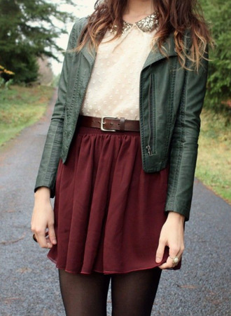 top white top green jacket red skater skirt brown belt black tights