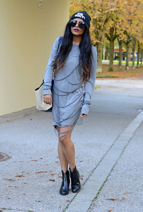 she wears fashion dress sunglasses hat bag shoes patent boots patent shoes ankle boots black boots grey dress long sleeves long sleeve dress beanie quote on it white bag mini dress