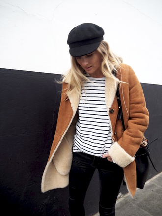 le fashion image blogger shearling jacket brown shearling jacket camel coat winter outfits winter coat hat stripes striped top bag black bag bucket bag top coat black hat