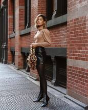 sweater,turtleneck sweater,knitted sweater,puffed sleeves,sock boots,tights,mini skirt,leather skirt,handbag,leopard print,earrings