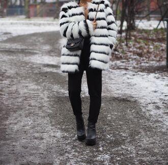 stylista blogger jumpsuit bag black and white faux fur jacket winter coat shoes hat jewels sunglasses
