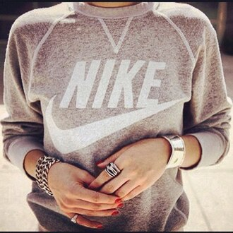 nike sweatshirt swag brand girl american nike sweater jewels old school ring vintage pullover sweater jewelry grey sweater crewneck this sweat isn't in nike store so where can i get it grey grey nike sweater blouse shirt top heather nike sweatshirt grey and white jumper pullover grunge shoes jacket pink nike top