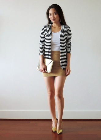 sensible stylista blogger striped jacket white top mini skirt clutch gold shoes