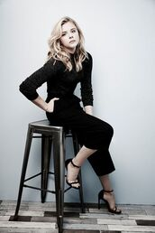 pants,chloe grace moretz,celebrity,editorial,black pants,wide-leg pants,top,black top,sandals,black sandals,black wide-leg velvet pants,cropped wide-leg velvet pants