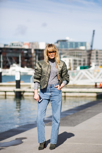 brooke testoni blogger top jeans sunglasses shoes jacket bomber jacket satin bomber khaki bomber jacket grey top long sleeves blue jeans pointed boots green boots high heels boots block heels velvet boots
