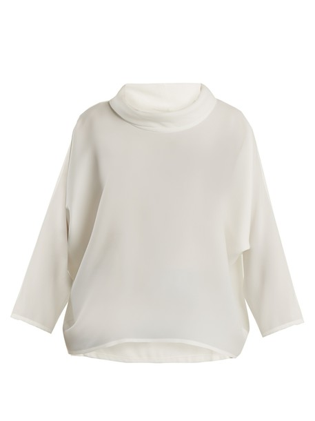 top draped white