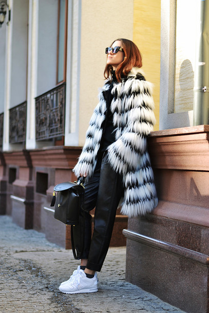 tina sizonova blogger fluffy white sneakers black pants leather backpack black and white mini backpack fur coat white coat black leather pants leather pants black backpack winter outfits winter outfits