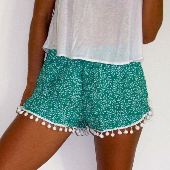 Green and white leaf print with large white pom pom's