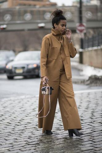 pants nyfw 2017 fashion week 2017 fashion week streetstyle wide-leg pants camel camel jacket matching set bag mini bag boots black boots high heels boots monochrome outfit