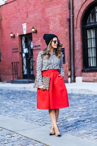 the corporate catwalk blogger shirt skirt sunglasses midi skirt red skirt pouch pom pom beanie