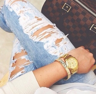 jeans ripped jeans blue light blue bag louis vuitton brown leather bag jewels luis vuitton marc by marc jacobs michael kors watch