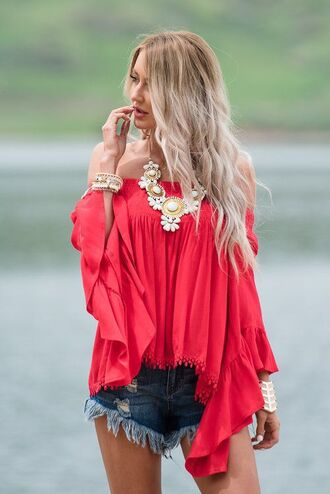 top red off shoulder top red top off the shoulder off the shoulder top bell sleeves frayed denim distressed denim shorts denim shorts blue shorts statement necklace necklace bracelets cuff bracelet jewels accessories