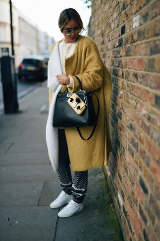 en vogue coop blogger black leather bag boyfriend coat mustard fuzzy coat oversized fall coat fall outfits fall colors printed pants our favorite accessories 2015