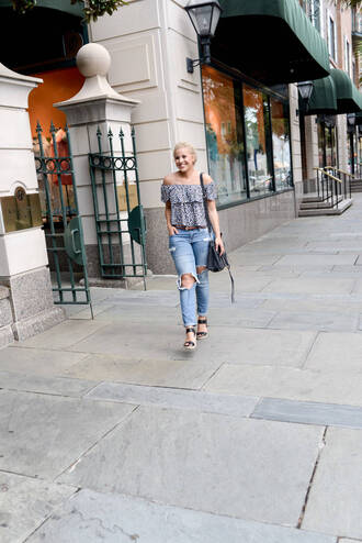 fashionably lo blogger top jeans bag shoes off the shoulder off the shoulder top ruffle ruffled top ripped jeans blue jeans sandals black sandals wedges wedge sandals black bag spring outfits
