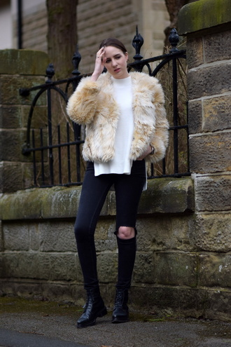 shot from the street blogger black ripped jeans faux fur jacket