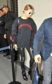sweater,milan fashion week 2016,pants,leather pants,hailey baldwin,model off-duty,sweatshirt,hood by air,all black everything