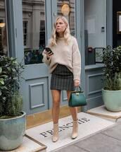 bag,handbag,leather bag,boots,mini skirt,checkered,oversized sweater,green bag,sweater