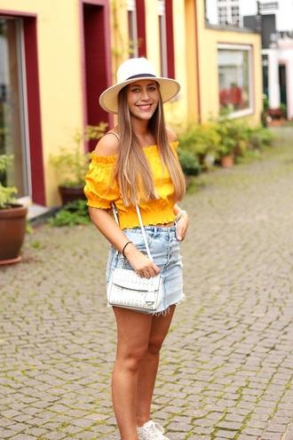 skirt denim skirt distressed denim summer hat blogger blogger style off the shoulder top white sneakers crossbody bag