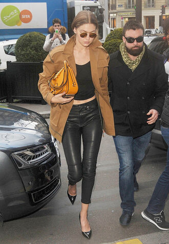 jacket gigi hadid model off-duty pants leather pants fashion week 2016 paris fashion week 2016 top sunglasses pumps purse spring outfits