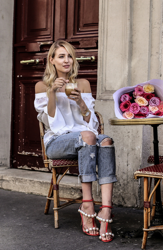 ohh couture blogger jewels bag shoes off the shoulder long sleeves white top ripped jeans grey jeans red heels white off shoulder top top off the shoulder top blue jeans cuffed jeans sandals sandal heels high heel sandals red sandals pearl