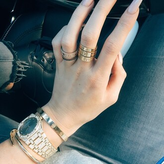 jewels ring rose gold rose gold ring cartier kylie jenner jewelry rings and tings gold ring cute rings bracelets jewelry gold keeping up with the kardashians kylie jenner stacked bracelets nail bracelet nail color michael kors watch watch diamonds