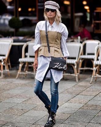 bag black bag shirt white shirt long shirt top sunglasses hat fisherman cap boots black boots jeans denim blue jeans