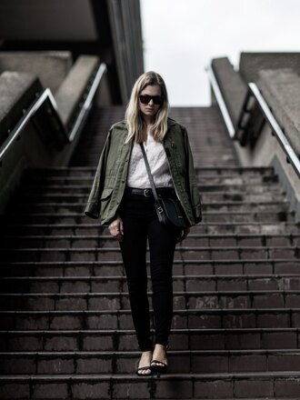 style and minimalism blogger shirt jacket shoes bag sunglasses belt jewels green jacket white top black jeans shoulder bag black bag sandals black sandals army green jacket white shirt crossbody bag sandal heels high heel sandals fall outfits pocket jacket