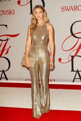 jumpsuit sequin jumpsuit sequins gold sequins gold sleeveless metallic clutch clutch gigi hadid celebrity style celebrity model