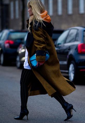 coat tumblr fashion week 2017 streetstyle green coat long coat oversized oversized coat boots black boots ankle boots high heels boots sweatshirt bag blue bag pants striped pants
