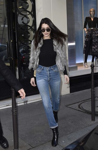 top bodycon bodysuit jeans jacket streetstyle bella hadid model off-duty fashion week 2016 paris fashion week 2016 long sleeve bodysuit fur coat long sleeves blue jeans cropped jeans mom jeans sunglasses