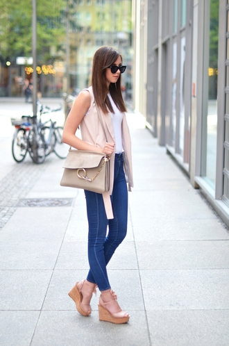 vogue haus blogger bag sunglasses jewels white top high waisted sleeveless coat nude bag wedges