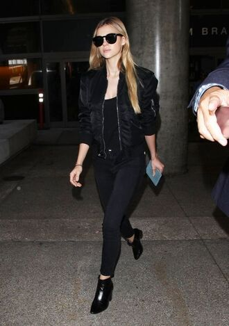 jacket nicola peltz celebrity style airport fashion jeans black jeans top black top bomber jacket black jacket sunglasses black sunglasses boots ankle boots black boots all black everything all black  outfit