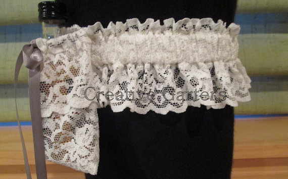 Handcrafted garter that can hold a mini shooter by creativegarters