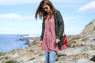 clochet blogger sweater dress jeans shoes bag sunglasses cardigan spring outfits red bag dress over pants bucket bag