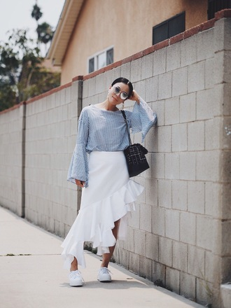 hallie daily blogger skirt sunglasses bag shoes jewels white skirt long sleeves stripes striped top black bag shoulder bag asymmetrical white sneakers round sunglasses