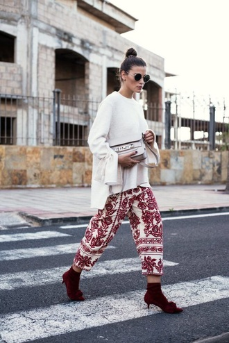 sweater white sweater pants printed pants cropped pants boots red boots bag bell sleeves ankle boots sunglasses