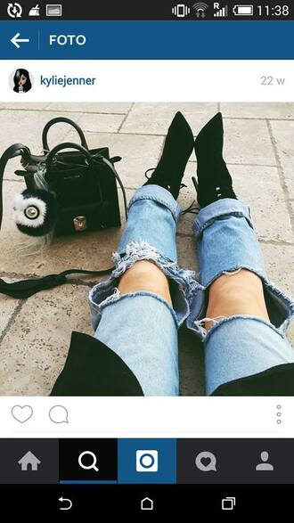 pants kylie jenner kendall jenner kardashians ripped jeans blue jeans white shirt haha no