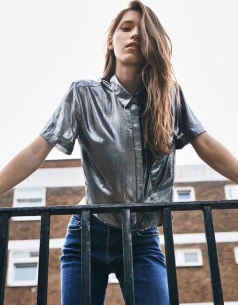 blouse metallic blouse top silver metallic tumblr outfit denim jeans blue jeans short sleeve long hair brunette french girl style boyish satin shirt